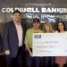 Center, Tim and Sheri Meech, winners of a giveaway from Coldwell Banker representatives, from left, Brad Pearson, Tom Pelton, Amy Sims and Jamie Duran.