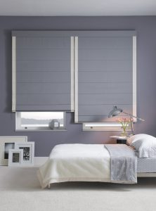 Hand-stitched pleats and aluminum dowels create horizontal seams that create this shade's sleek, free-falling appearance.