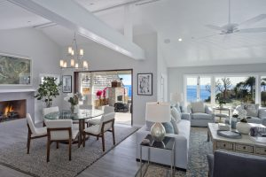 Charm is preserved with ocean views and the original porch leading to the deck.
